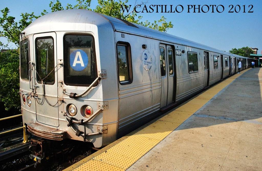 (348k, 1024x672)<br><b>Country:</b> United States<br><b>City:</b> New York<br><b>System:</b> New York City Transit<br><b>Line:</b> IND Rockaway Line<br><b>Location:</b> Mott Avenue/Far Rockaway<br><b>Route:</b> A<br><b>Car:</b> R-46 (Pullman-Standard, 1974-75) 5876 <br><b>Photo by:</b> Wilfredo Castillo<br><b>Date:</b> 7/26/2012<br><b>Viewed (this week/total):</b> 1 / 1155