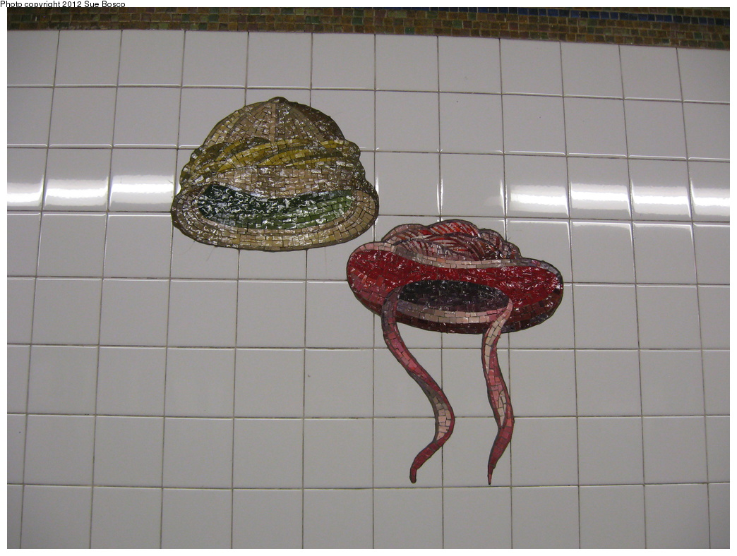 (271k, 1044x788)<br><b>Country:</b> United States<br><b>City:</b> New York<br><b>System:</b> New York City Transit<br><b>Line:</b> BMT Broadway Line<br><b>Location:</b> 23rd Street<br><b>Photo by:</b> Sue Bosco<br><b>Date:</b> 4/25/2012<br><b>Artwork:</b> <i>Memories of Twenty-Third Street</i>, Keith Godard, 2002<br><b>Notes:</b> Stanford White's and Evelyn Nesbit's hats.<br><b>Viewed (this week/total):</b> 0 / 1745