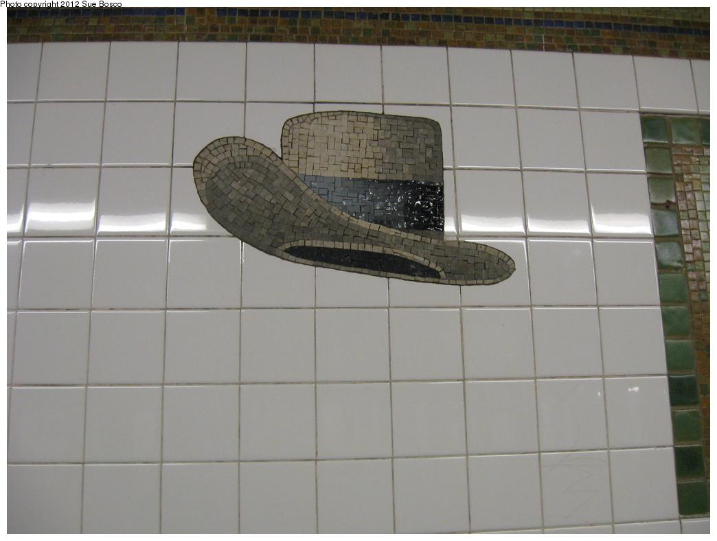 (250k, 1044x788)<br><b>Country:</b> United States<br><b>City:</b> New York<br><b>System:</b> New York City Transit<br><b>Line:</b> BMT Broadway Line<br><b>Location:</b> 23rd Street<br><b>Photo by:</b> Sue Bosco<br><b>Date:</b> 4/25/2012<br><b>Artwork:</b> <i>Memories of Twenty-Third Street</i>, Keith Godard, 2002<br><b>Notes:</b> John Barrymore's hat.<br><b>Viewed (this week/total):</b> 0 / 1707