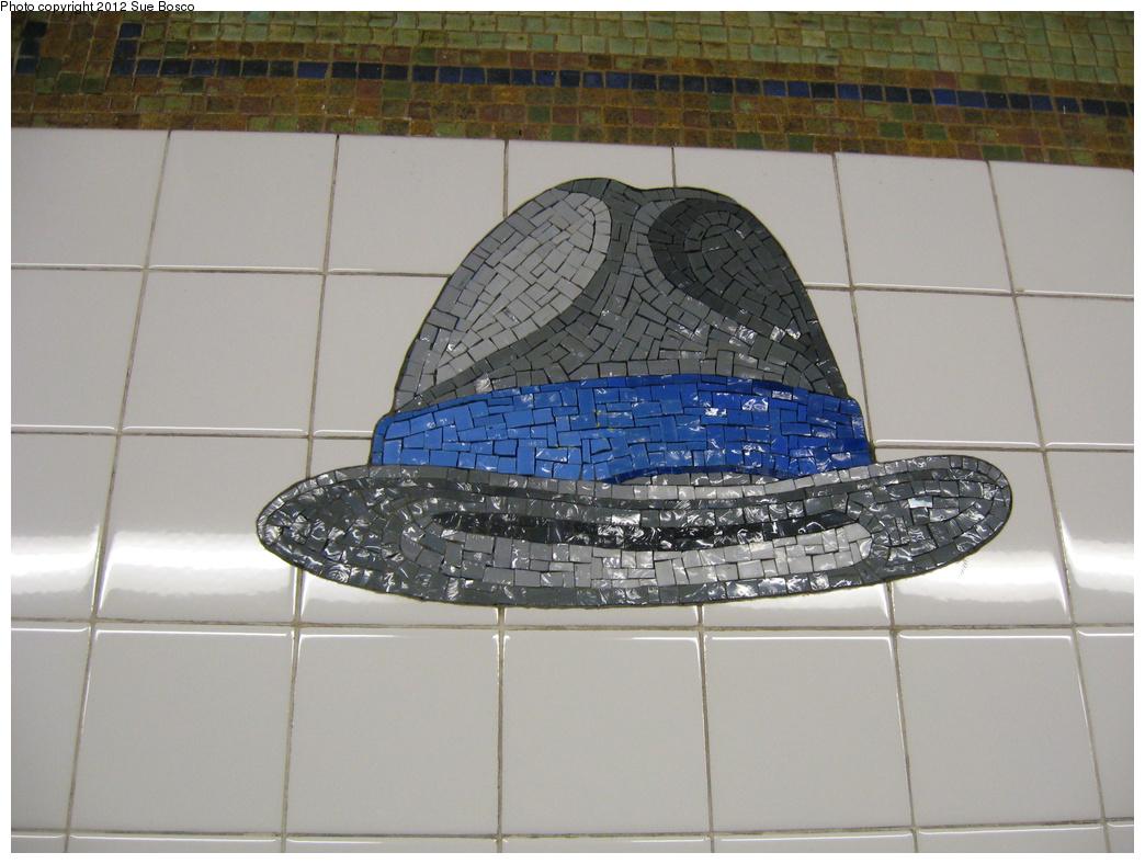 (303k, 1044x788)<br><b>Country:</b> United States<br><b>City:</b> New York<br><b>System:</b> New York City Transit<br><b>Line:</b> BMT Broadway Line<br><b>Location:</b> 23rd Street<br><b>Photo by:</b> Sue Bosco<br><b>Date:</b> 4/25/2012<br><b>Artwork:</b> <i>Memories of Twenty-Third Street</i>, Keith Godard, 2002<br><b>Notes:</b> Charles Ives's hat.<br><b>Viewed (this week/total):</b> 0 / 1750