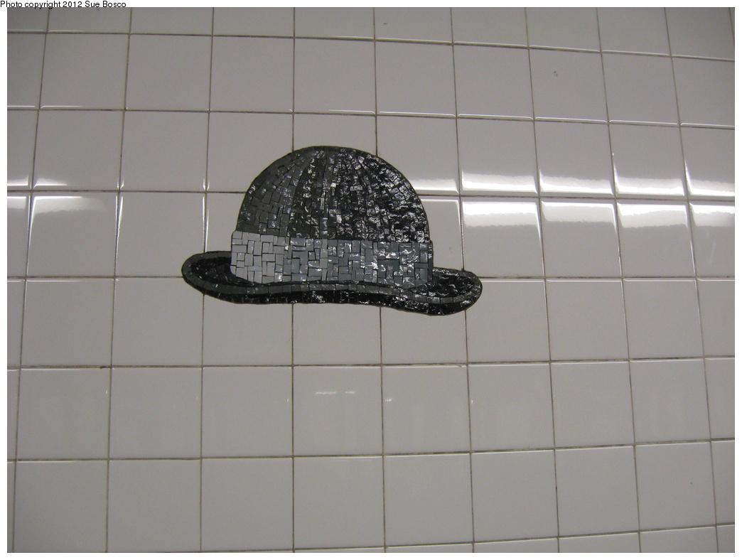 (231k, 1044x788)<br><b>Country:</b> United States<br><b>City:</b> New York<br><b>System:</b> New York City Transit<br><b>Line:</b> BMT Broadway Line<br><b>Location:</b> 23rd Street<br><b>Photo by:</b> Sue Bosco<br><b>Date:</b> 4/25/2012<br><b>Artwork:</b> <i>Memories of Twenty-Third Street</i>, Keith Godard, 2002<br><b>Notes:</b> Scott Joplin's hat.<br><b>Viewed (this week/total):</b> 0 / 1768