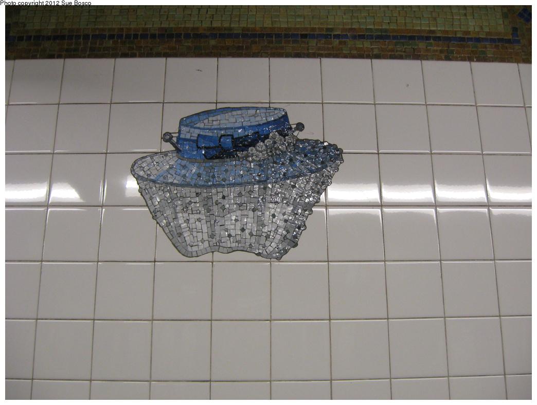 (267k, 1044x788)<br><b>Country:</b> United States<br><b>City:</b> New York<br><b>System:</b> New York City Transit<br><b>Line:</b> BMT Broadway Line<br><b>Location:</b> 23rd Street<br><b>Photo by:</b> Sue Bosco<br><b>Date:</b> 4/25/2012<br><b>Artwork:</b> <i>Memories of Twenty-Third Street</i>, Keith Godard, 2002<br><b>Notes:</b> Eleanor Roosevelt's hat.<br><b>Viewed (this week/total):</b> 0 / 1620