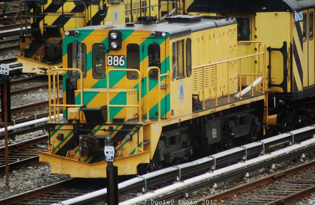 (371k, 1024x668)<br><b>Country:</b> United States<br><b>City:</b> New York<br><b>System:</b> New York City Transit<br><b>Location:</b> 36th Street Yard<br><b>Route:</b> Work Service<br><b>Car:</b> R-77 Locomotive 886 <br><b>Photo by:</b> John Dooley<br><b>Date:</b> 10/28/2012<br><b>Viewed (this week/total):</b> 1 / 930