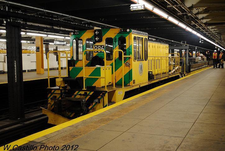 (124k, 724x486)<br><b>Country:</b> United States<br><b>City:</b> New York<br><b>System:</b> New York City Transit<br><b>Line:</b> IND Crosstown Line<br><b>Location:</b> 7th Avenue/Park Slope<br><b>Route:</b> Work Service<br><b>Car:</b> R-77 Locomotive 886 <br><b>Photo by:</b> Wilfredo Castillo<br><b>Date:</b> 12/15/2012<br><b>Viewed (this week/total):</b> 3 / 1498