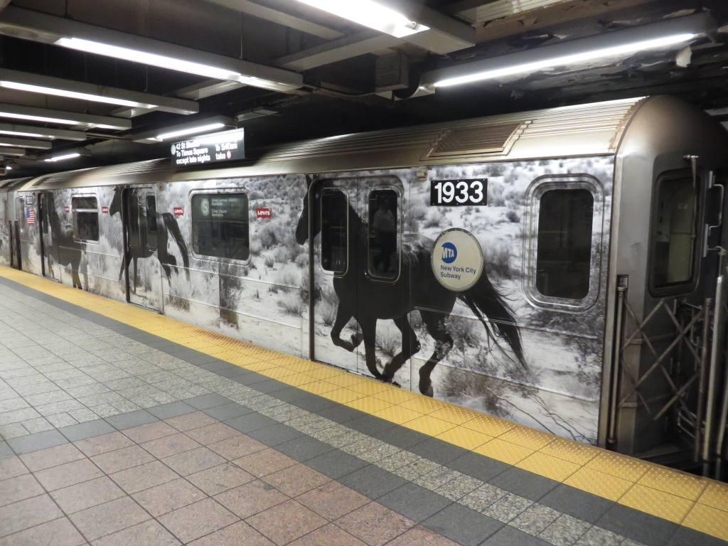 (127k, 1024x768)<br><b>Country:</b> United States<br><b>City:</b> New York<br><b>System:</b> New York City Transit<br><b>Line:</b> IRT Times Square-Grand Central Shuttle<br><b>Location:</b> Grand Central<br><b>Route:</b> S<br><b>Car:</b> R-62A (Bombardier, 1984-1987) 1933 <br><b>Photo by:</b> Robbie Rosenfeld<br><b>Date:</b> 9/15/2013<br><b>Notes:</b> Levis ad wrap<br><b>Viewed (this week/total):</b> 4 / 953