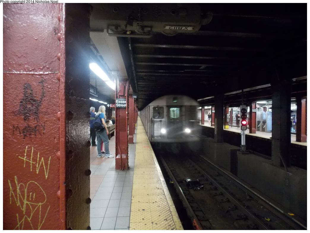 (305k, 1044x788)<br><b>Country:</b> United States<br><b>City:</b> New York<br><b>System:</b> New York City Transit<br><b>Line:</b> BMT Nassau Street-Jamaica Line<br><b>Location:</b> Essex Street<br><b>Route:</b> J<br><b>Car:</b> R-32 (Budd, 1964)  <br><b>Photo by:</b> Nicholas Noel<br><b>Date:</b> 6/7/2014<br><b>Viewed (this week/total):</b> 1 / 1729