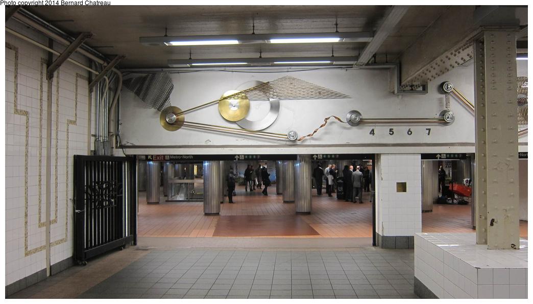 (229k, 1044x595)<br><b>Country:</b> United States<br><b>City:</b> New York<br><b>System:</b> New York City Transit<br><b>Line:</b> IRT Times Square-Grand Central Shuttle<br><b>Location:</b> Grand Central<br><b>Photo by:</b> Bernard Chatreau<br><b>Date:</b> 4/8/2011<br><b>Artwork:</b> <i>Fast Track & Speed Wheels</i>, Dan Sinclair, 1990<br><b>Viewed (this week/total):</b> 14 / 1577