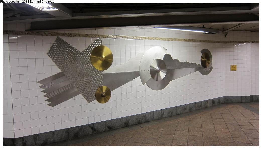 (202k, 1044x595)<br><b>Country:</b> United States<br><b>City:</b> New York<br><b>System:</b> New York City Transit<br><b>Line:</b> IRT Times Square-Grand Central Shuttle<br><b>Location:</b> Grand Central<br><b>Photo by:</b> Bernard Chatreau<br><b>Date:</b> 4/8/2011<br><b>Artwork:</b> <i>Fast Track & Speed Wheels</i>, Dan Sinclair, 1990<br><b>Viewed (this week/total):</b> 3 / 1439