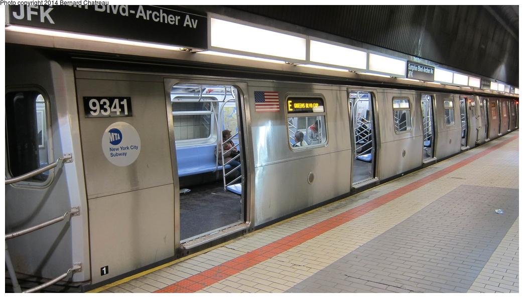 (248k, 1044x595)<br><b>Country:</b> United States<br><b>City:</b> New York<br><b>System:</b> New York City Transit<br><b>Line:</b> IND Queens Boulevard Line<br><b>Location:</b> Sutphin Blvd.-Archer Ave./JFK<br><b>Route:</b> E<br><b>Car:</b> R-160A (Option 1) (Alstom, 2008-2009, 5 car sets) 9341 <br><b>Photo by:</b> Bernard Chatreau<br><b>Date:</b> 4/8/2011<br><b>Viewed (this week/total):</b> 6 / 1170