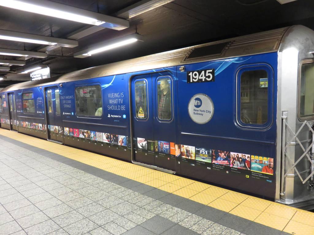 (139k, 1024x768)<br><b>Country:</b> United States<br><b>City:</b> New York<br><b>System:</b> New York City Transit<br><b>Line:</b> IRT Times Square-Grand Central Shuttle<br><b>Location:</b> Grand Central<br><b>Route:</b> S<br><b>Car:</b> R-62A (Bombardier, 1984-1987) 1945 <br><b>Photo by:</b> Robbie Rosenfeld<br><b>Date:</b> 10/14/2015<br><b>Notes:</b> Playstation wrap.<br><b>Viewed (this week/total):</b> 9 / 964