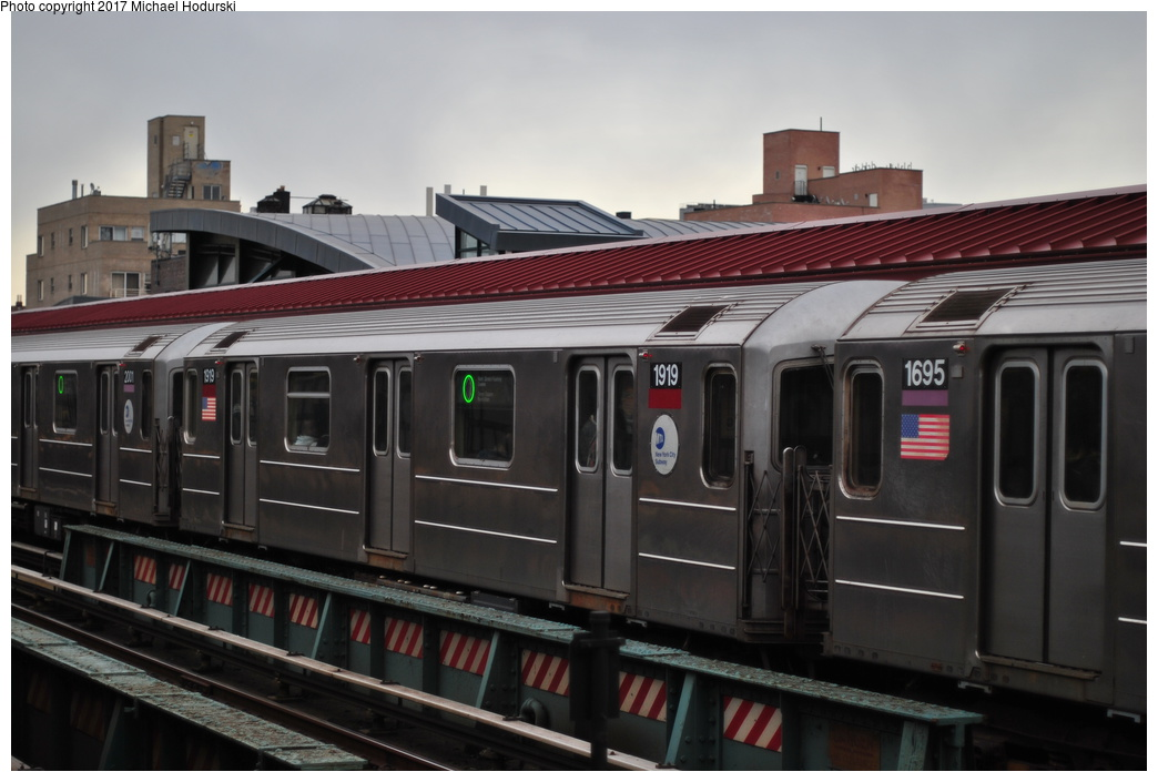 (252k, 1044x705)<br><b>Country:</b> United States<br><b>City:</b> New York<br><b>System:</b> New York City Transit<br><b>Line:</b> IRT Flushing Line<br><b>Location:</b> 74th Street/Broadway<br><b>Route:</b> 7<br><b>Car:</b> R-62A (Bombardier, 1984-1987) 1919 <br><b>Photo by:</b> Michael Hodurski<br><b>Date:</b> 1/20/2014<br><b>Viewed (this week/total):</b> 1 / 724