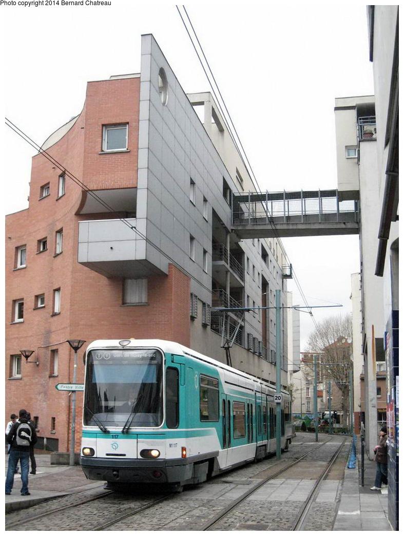 (296k, 787x1045)<br><b>Country:</b> France<br><b>City:</b> Paris<br><b>System:</b> RATP (Régie Autonome des Transports Parisiens)<br><b>Line:</b> Tram T1<br><b>Location:</b> Basilique de Saint-Denis (Hôtel de Ville)<br><b>Car:</b> Alstom TFS (Tramway Français Standard) 117 <br><b>Photo by:</b> Bernard Chatreau<br><b>Date:</b> 4/8/2009<br><b>Viewed (this week/total):</b> 2 / 125