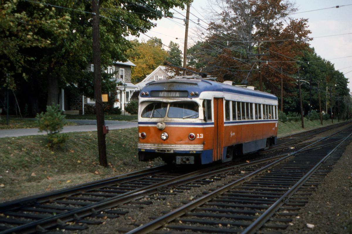 (540k, 1200x800)<br><b>Country:</b> United States<br><b>City:</b> Philadelphia, PA<br><b>System:</b> SEPTA (or Predecessor)<br><b>Line:</b> Rt. 101-Media/102-Sharon Hill<br><b>Location:</b> N. of Drexel Hill Jct.<br><b>Car:</b> PSTC Streamliner (St. Louis Car Co., 1949) 13 <br><b>Collection of:</b> David Pirmann<br><b>Date:</b> 11/1980<br><b>Viewed (this week/total):</b> 1 / 93
