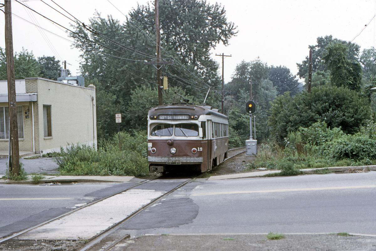 (592k, 1200x800)<br><b>Country:</b> United States<br><b>City:</b> Philadelphia, PA<br><b>System:</b> SEPTA (or Predecessor)<br><b>Line:</b> Rt. 101-Media<br><b>Location:</b> Woodland Avenue<br><b>Car:</b> PSTC Streamliner (St. Louis Car Co., 1949) 19 <br><b>Collection of:</b> David Pirmann<br><b>Date:</b> 8/1974<br><b>Viewed (this week/total):</b> 1 / 90
