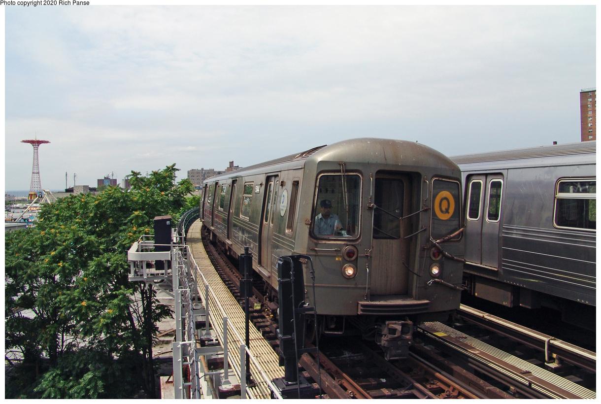 (466k, 1220x820)<br><b>Country:</b> United States<br><b>City:</b> New York<br><b>System:</b> New York City Transit<br><b>Line:</b> BMT Brighton Line<br><b>Location:</b> West 8th Street<br><b>Route:</b> Q<br><b>Car:</b> R-68A (Kawasaki, 1988-1989) 5144 <br><b>Photo by:</b> Richard Panse<br><b>Date:</b> 7/25/2004<br><b>Viewed (this week/total):</b> 1 / 104