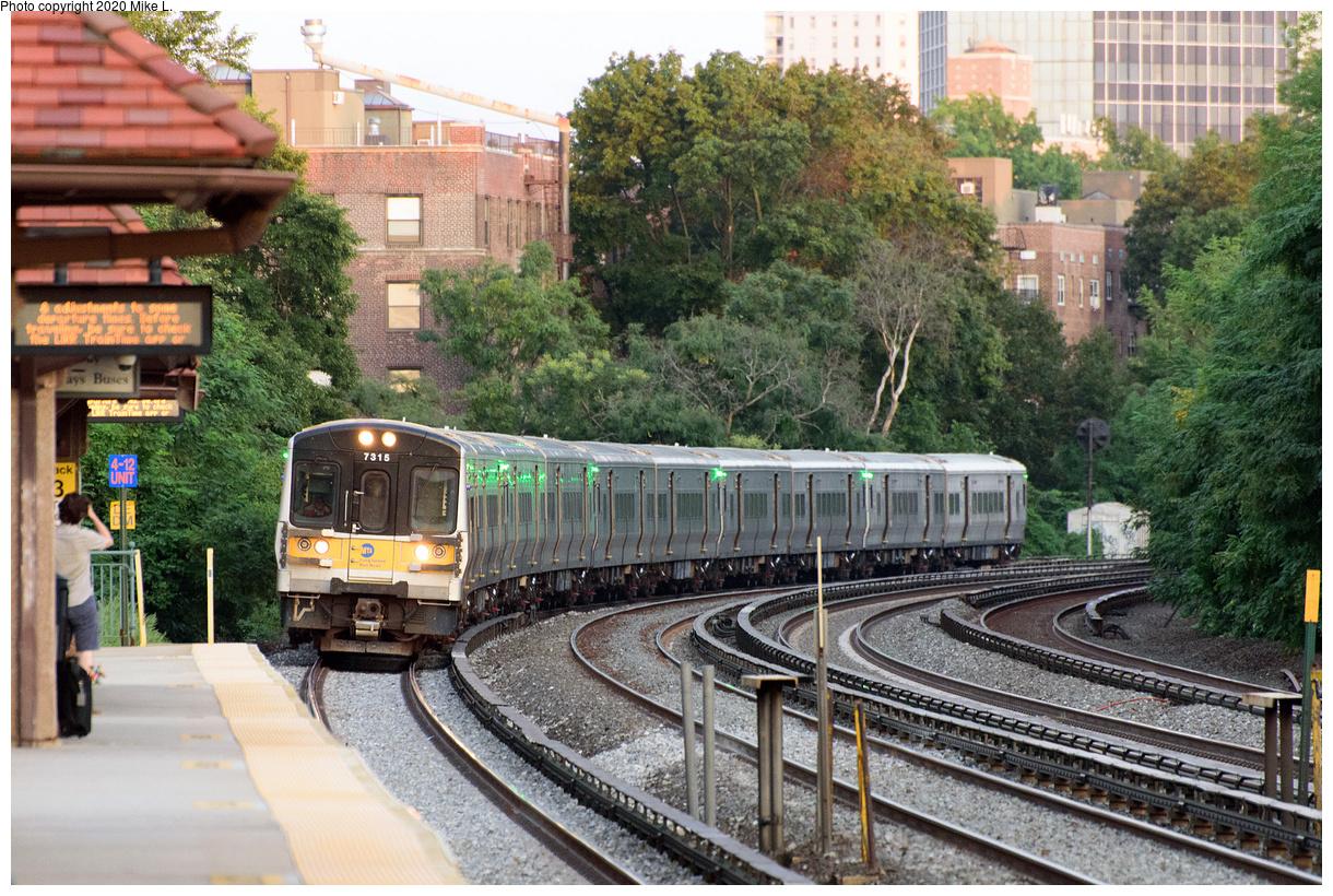 (636k, 1220x820)<br><b>Country:</b> United States<br><b>City:</b> New York<br><b>System:</b> Long Island Rail Road<br><b>Line:</b> LIRR Main Line<br><b>Location:</b> Forest Hills<br><b>Car:</b> LIRR M-7 EMU (Bombardier) 7315 <br><b>Photo by:</b> Mike L.<br><b>Date:</b> 9/7/2020<br><b>Viewed (this week/total):</b> 2 / 231
