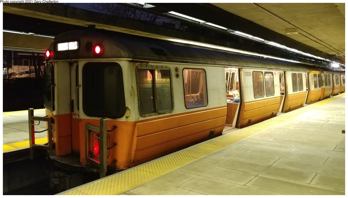 (273k, 1220x695)<br><b>Country:</b> United States<br><b>City:</b> Boston, MA<br><b>System:</b> MBTA<br><b>Line:</b> MBTA Orange Line<br><b>Location:</b> Sullivan Square<br><b>Car:</b> MBTA 01200 Series (Hawker-Siddley, 1980-1981) 01239 <br><b>Photo by:</b> Gary Chatterton<br><b>Date:</b> 4/25/2018<br><b>Viewed (this week/total):</b> 5 / 32