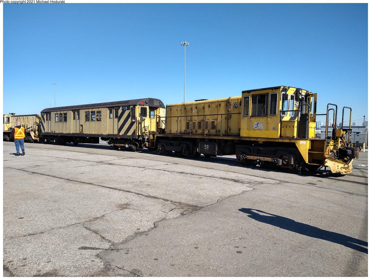 (568k, 1220x920)<br><b>Country:</b> United States<br><b>City:</b> New York<br><b>System:</b> New York City Transit<br><b>Line:</b> South Brooklyn Railway<br><b>Location:</b> SBK Yard (2nd Ave at 38th St.) (SBK)<br><b>Car:</b> R-41 Locomotive 59 <br><b>Photo by:</b> Michael Hodurski<br><b>Date:</b> 2/26/2021<br><b>Notes:</b> Delivery of new flat cars.<br><b>Viewed (this week/total):</b> 0 / 261