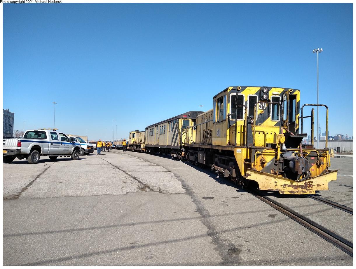 (602k, 1220x920)<br><b>Country:</b> United States<br><b>City:</b> New York<br><b>System:</b> New York City Transit<br><b>Line:</b> South Brooklyn Railway<br><b>Location:</b> SBK Yard (2nd Ave at 38th St.) (SBK)<br><b>Car:</b> R-41 Locomotive 59 <br><b>Photo by:</b> Michael Hodurski<br><b>Date:</b> 2/26/2021<br><b>Notes:</b> Delivery of new flat cars.<br><b>Viewed (this week/total):</b> 0 / 290