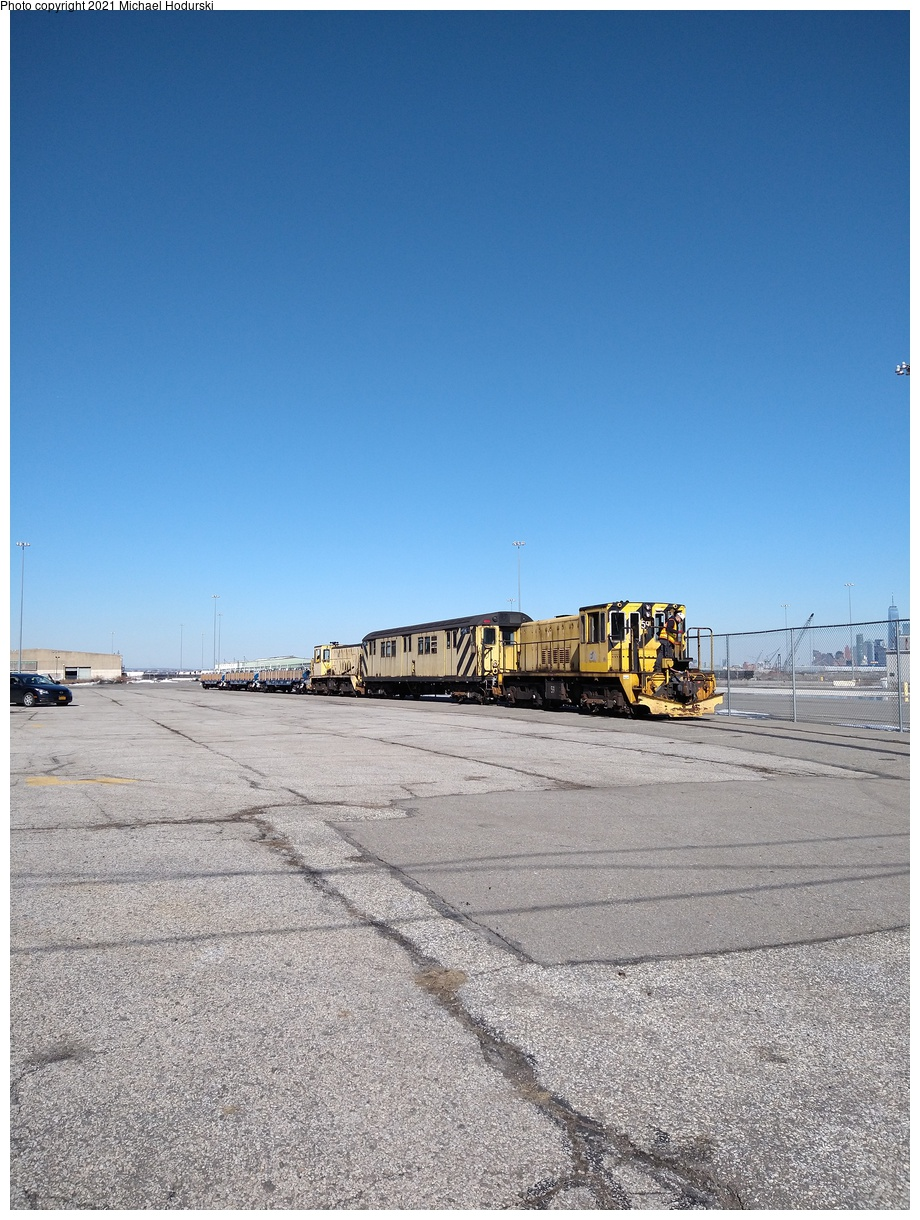 (421k, 920x1220)<br><b>Country:</b> United States<br><b>City:</b> New York<br><b>System:</b> New York City Transit<br><b>Line:</b> South Brooklyn Railway<br><b>Location:</b> SBK Yard (2nd Ave at 38th St.) (SBK)<br><b>Car:</b> R-41 Locomotive 59 <br><b>Photo by:</b> Michael Hodurski<br><b>Date:</b> 2/26/2021<br><b>Notes:</b> Delivery of new flat cars.<br><b>Viewed (this week/total):</b> 0 / 310