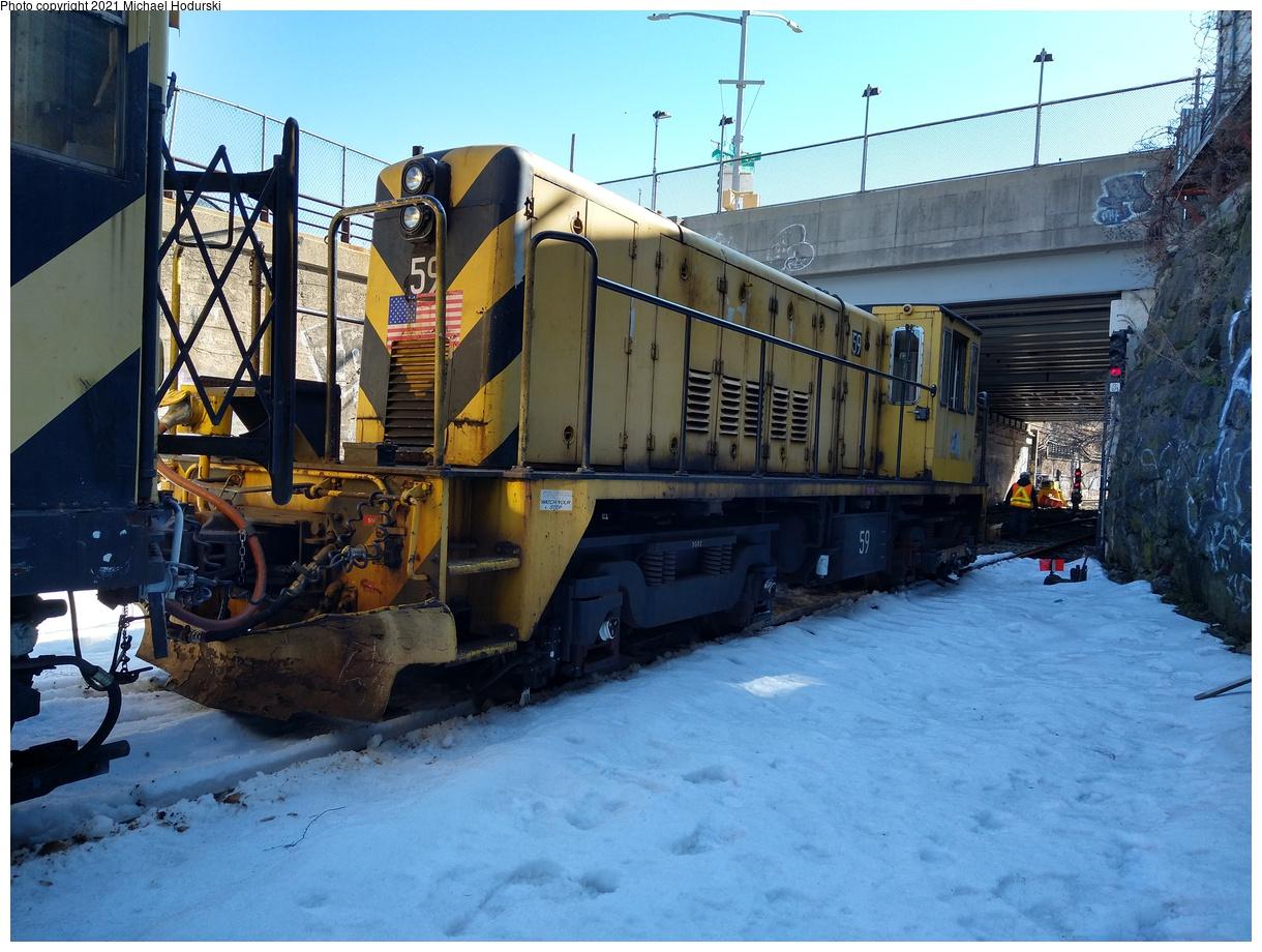 (506k, 1220x920)<br><b>Country:</b> United States<br><b>City:</b> New York<br><b>System:</b> New York City Transit<br><b>Line:</b> South Brooklyn Railway<br><b>Location:</b> 39th St Yard (bet. 4th & 3rd Aves) (SBK)<br><b>Car:</b> R-41 Locomotive 59 <br><b>Photo by:</b> Michael Hodurski<br><b>Date:</b> 2/26/2021<br><b>Notes:</b> Delivery of new flat cars.<br><b>Viewed (this week/total):</b> 1 / 567