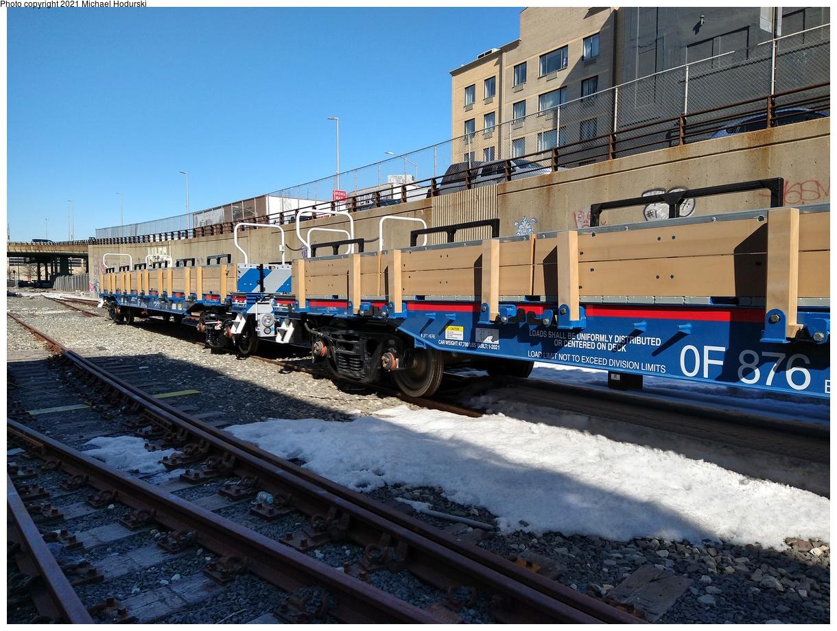 (569k, 1220x920)<br><b>Country:</b> United States<br><b>City:</b> New York<br><b>System:</b> New York City Transit<br><b>Line:</b> South Brooklyn Railway<br><b>Location:</b> 39th St Yard (bet. 4th & 3rd Aves) (SBK)<br><b>Car:</b> Flat Car 876 <br><b>Photo by:</b> Michael Hodurski<br><b>Date:</b> 2/26/2021<br><b>Notes:</b> Delivery of new flat cars.<br><b>Viewed (this week/total):</b> 0 / 253