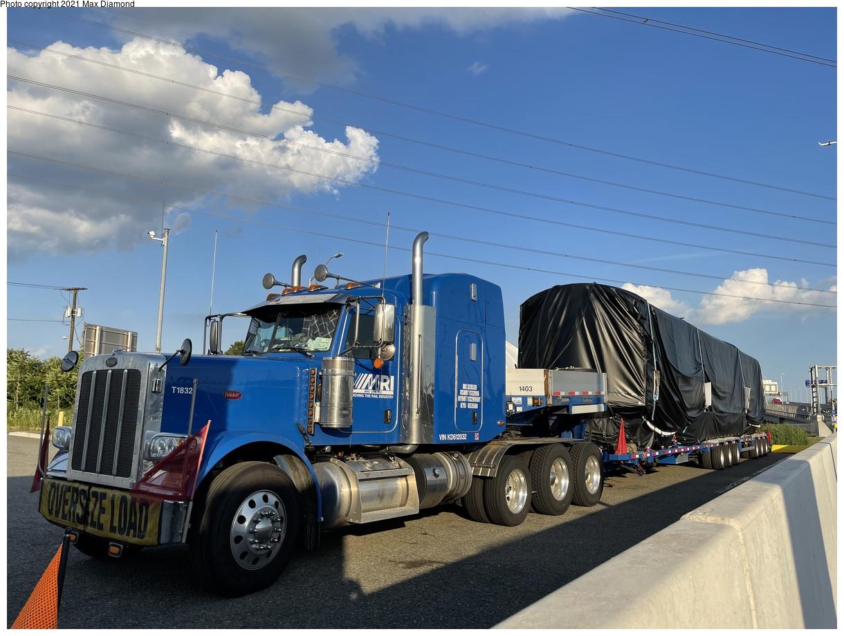 (364k, 1220x920)<br><b>Country:</b> United States<br><b>City:</b> New York<br><b>System:</b> New York City Transit<br><b>Car:</b> R-211 (Kawasaki, 2021-) 4063 <br><b>Photo by:</b> Max Diamond<br><b>Date:</b> 6/28/2021<br><b>Notes:</b> R-211 delivery at Goethals Bridge oversized load staging area.<br><b>Viewed (this week/total):</b> 4 / 180