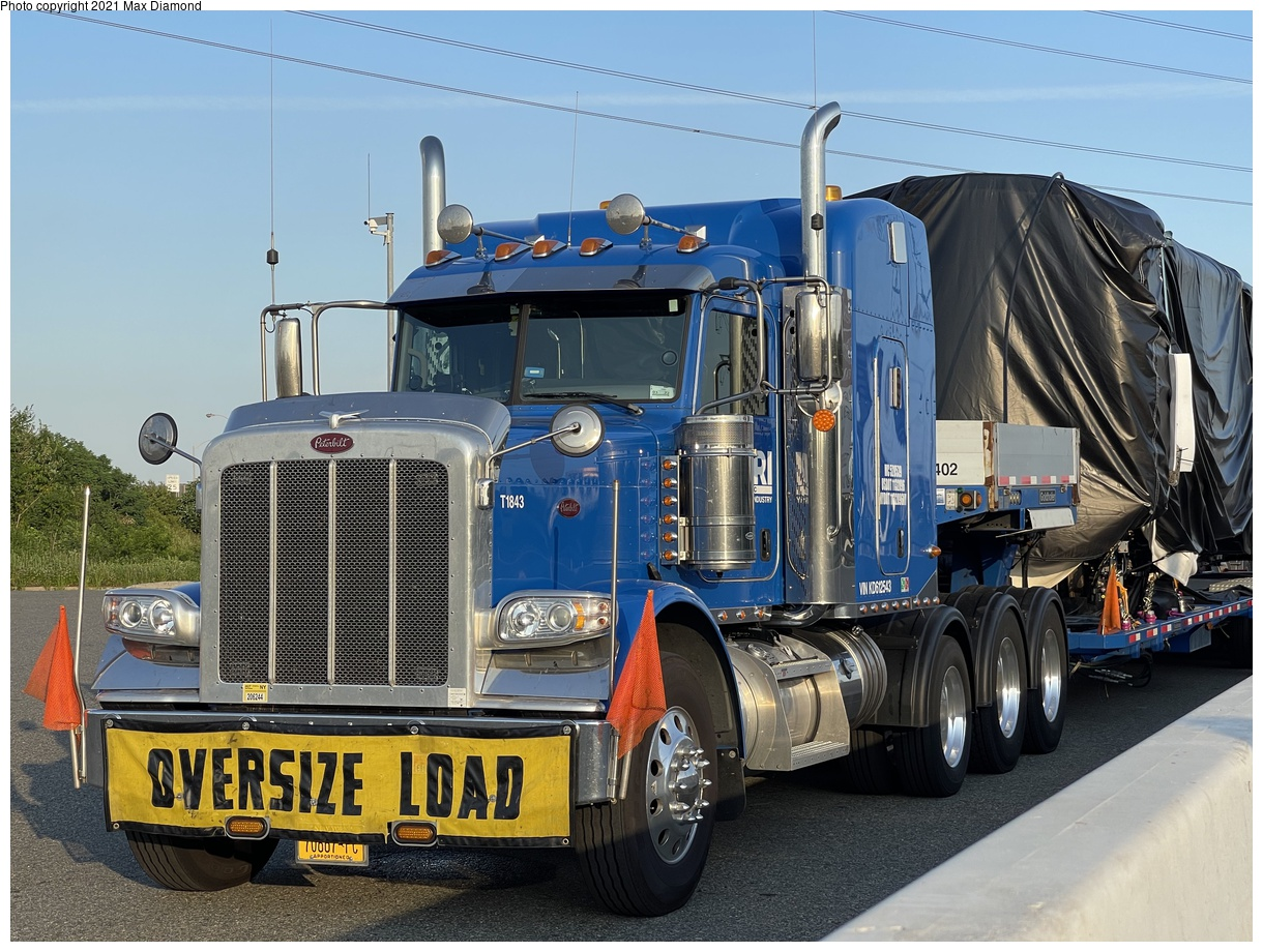 (442k, 1220x920)<br><b>Country:</b> United States<br><b>City:</b> New York<br><b>System:</b> New York City Transit<br><b>Car:</b> R-211 (Kawasaki, 2021-) 4064 <br><b>Photo by:</b> Max Diamond<br><b>Date:</b> 6/28/2021<br><b>Notes:</b> R-211 delivery at Goethals Bridge oversized load staging area.<br><b>Viewed (this week/total):</b> 4 / 115