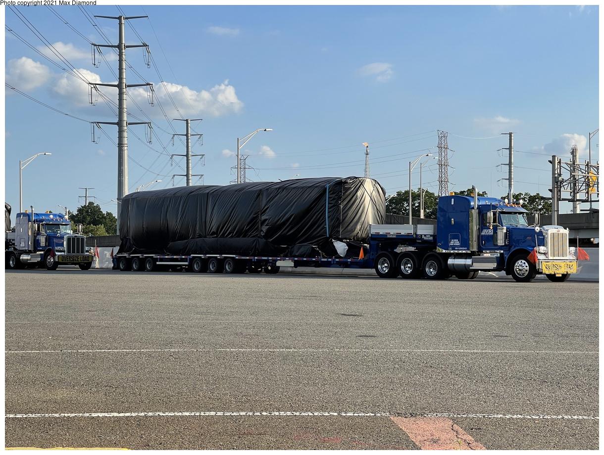 (502k, 1220x920)<br><b>Country:</b> United States<br><b>City:</b> New York<br><b>System:</b> New York City Transit<br><b>Car:</b> R-211 (Kawasaki, 2021-) 4064 <br><b>Photo by:</b> Max Diamond<br><b>Date:</b> 6/28/2021<br><b>Notes:</b> R-211 delivery at Goethals Bridge oversized load staging area.<br><b>Viewed (this week/total):</b> 12 / 183