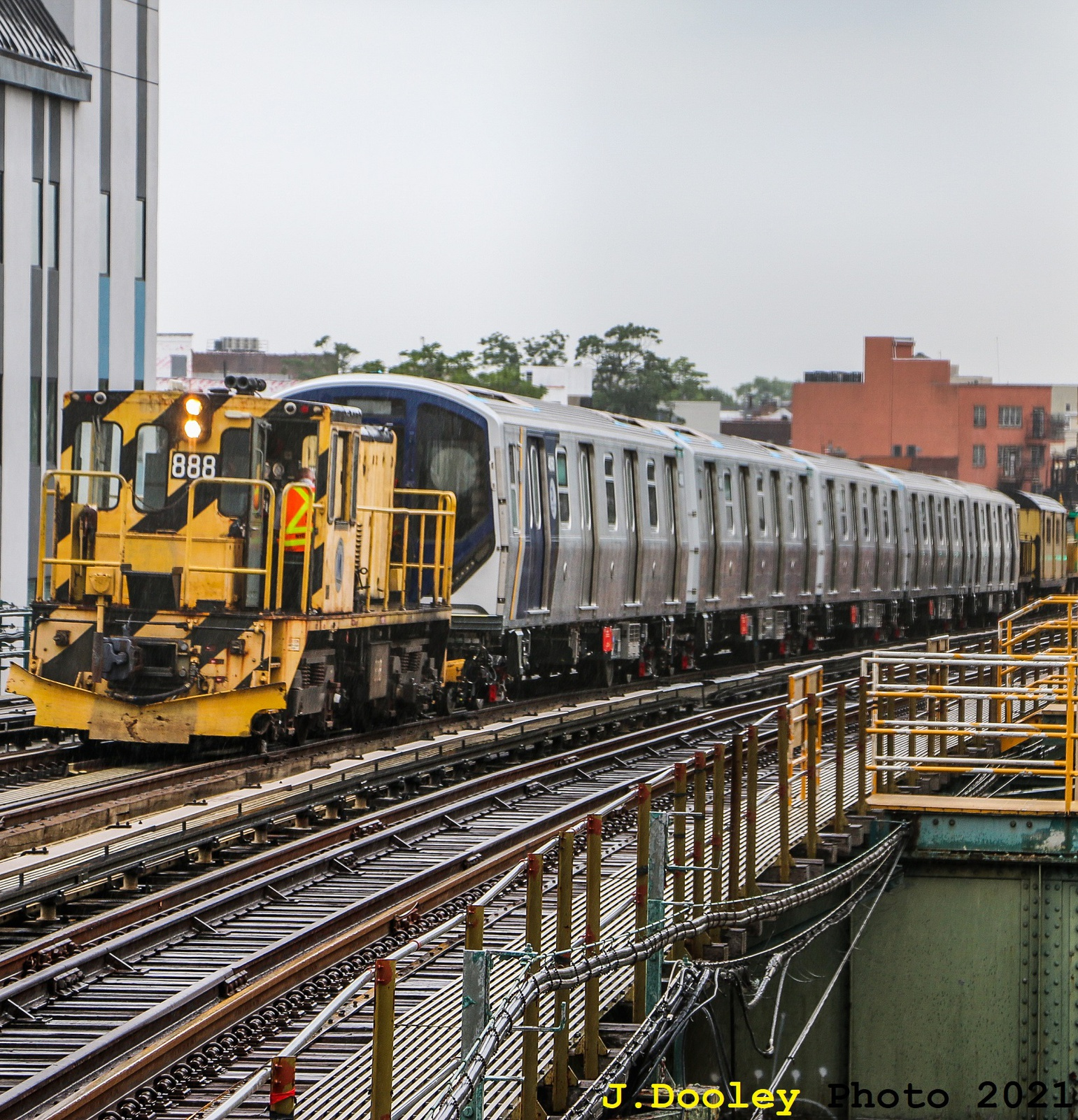 (1041k, 1541x1600)<br><b>Country:</b> United States<br><b>City:</b> New York<br><b>System:</b> New York City Transit<br><b>Line:</b> BMT West End Line<br><b>Location:</b> Fort Hamilton Parkway<br><b>Car:</b> R-77 Locomotive 888 <br><b>Photo by:</b> John Dooley<br><b>Date:</b> 7/1/2021<br><b>Notes:</b> R-211 being towed on West End Line to Coney Island.<br><b>Viewed (this week/total):</b> 4 / 237