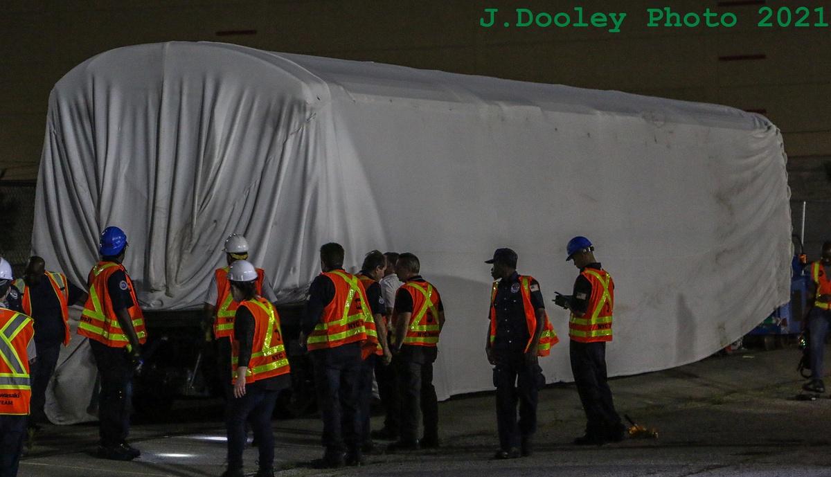 (291k, 1200x689)<br><b>Country:</b> United States<br><b>City:</b> New York<br><b>System:</b> New York City Transit<br><b>Car:</b> R-211 (Kawasaki, 2021-)  <br><b>Photo by:</b> John Dooley<br><b>Date:</b> 6/29/2021<br><b>Notes:</b> Night-time delivery of first R-211 cars.<br><b>Viewed (this week/total):</b> 2 / 117