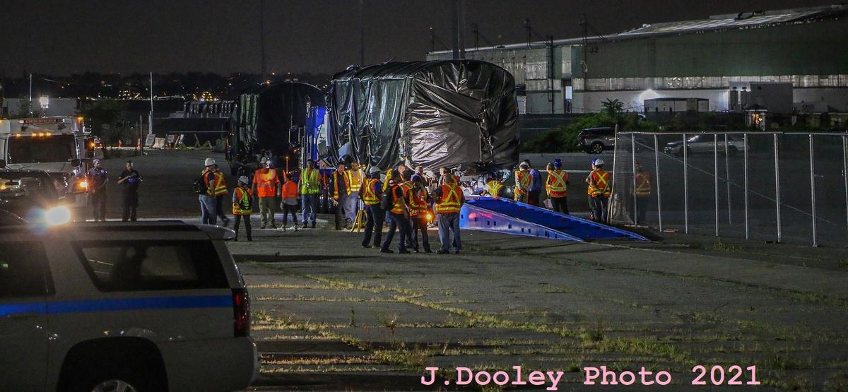 (300k, 1200x555)<br><b>Country:</b> United States<br><b>City:</b> New York<br><b>System:</b> New York City Transit<br><b>Car:</b> R-211 (Kawasaki, 2021-)  <br><b>Photo by:</b> John Dooley<br><b>Date:</b> 6/29/2021<br><b>Notes:</b> Night-time delivery of first R-211 cars.<br><b>Viewed (this week/total):</b> 0 / 227