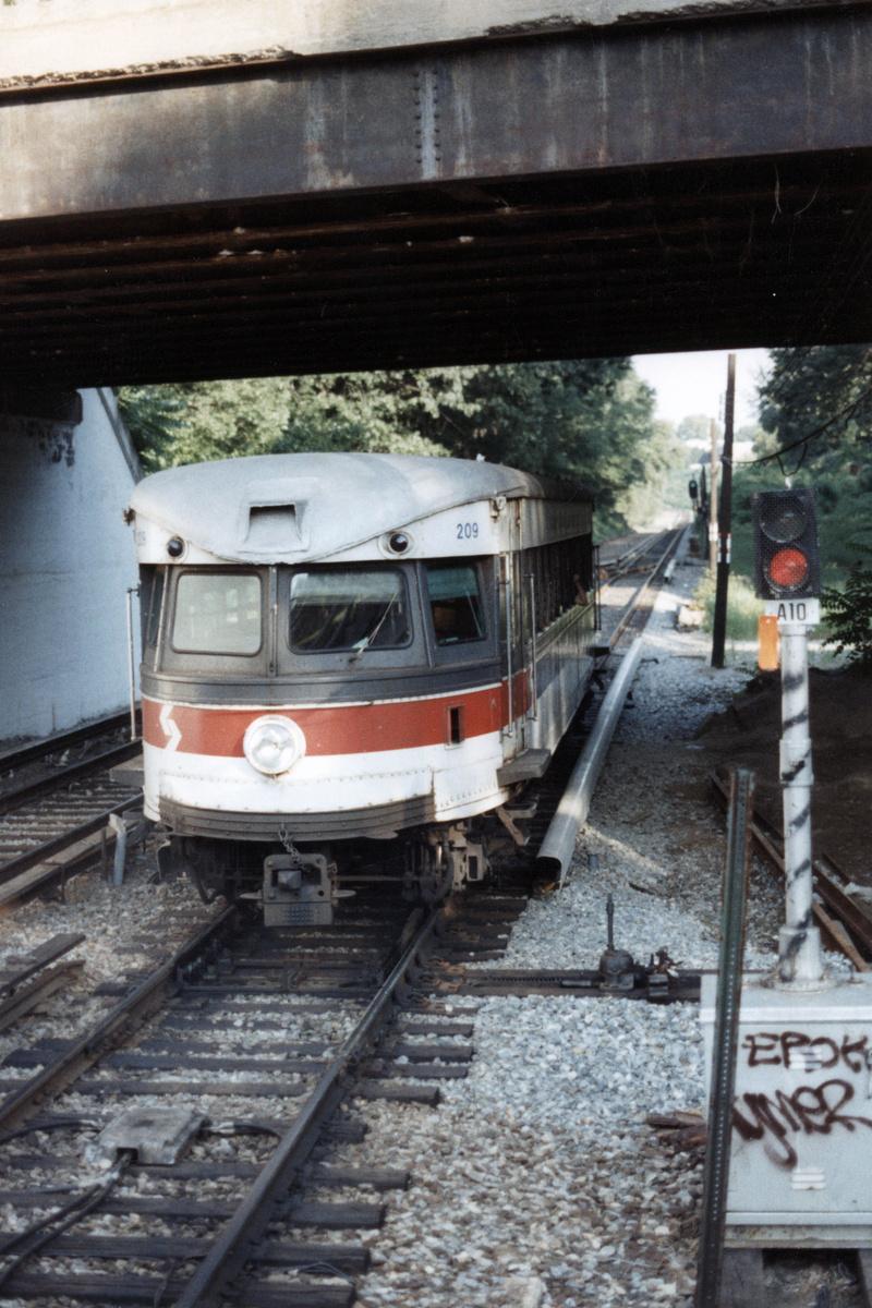 (465k, 800x1200)<br><b>Country:</b> United States<br><b>City:</b> Philadelphia, PA<br><b>System:</b> SEPTA (or Predecessor)<br><b>Line:</b> 100-Norristown<br><b>Location:</b> Norristown line-Loc. unknown.<br><b>Car:</b> PSTC/SEPTA Bullet (J.G. Brill Co., 1931-1934) 209 <br><b>Collection of:</b> David Pirmann<br><b>Date:</b> 1987<br><b>Notes:</b> Summer 1987<br><b>Viewed (this week/total):</b> 5 / 14