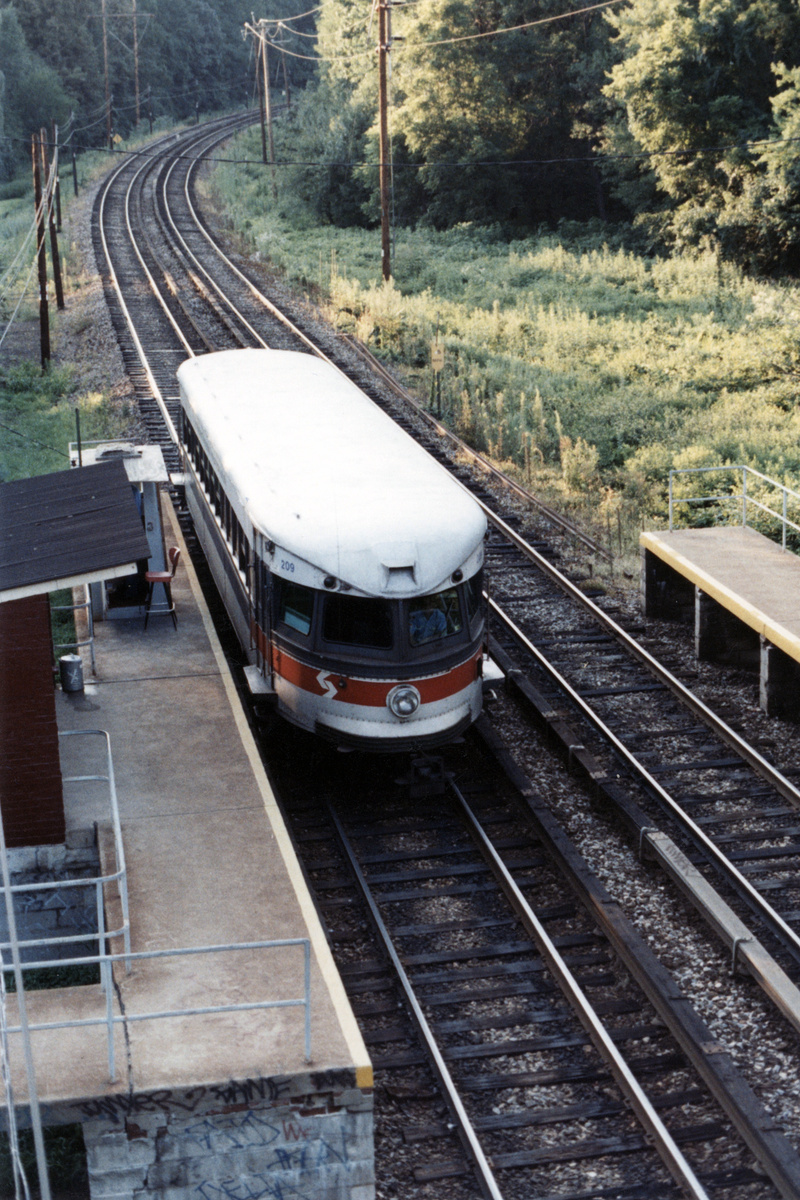 (543k, 800x1200)<br><b>Country:</b> United States<br><b>City:</b> Philadelphia, PA<br><b>System:</b> SEPTA (or Predecessor)<br><b>Line:</b> 100-Norristown<br><b>Location:</b> Norristown line-Loc. unknown.<br><b>Car:</b> PSTC/SEPTA Bullet (J.G. Brill Co., 1931-1934) 209 <br><b>Collection of:</b> David Pirmann<br><b>Date:</b> 1987<br><b>Notes:</b> Summer 1987<br><b>Viewed (this week/total):</b> 5 / 21
