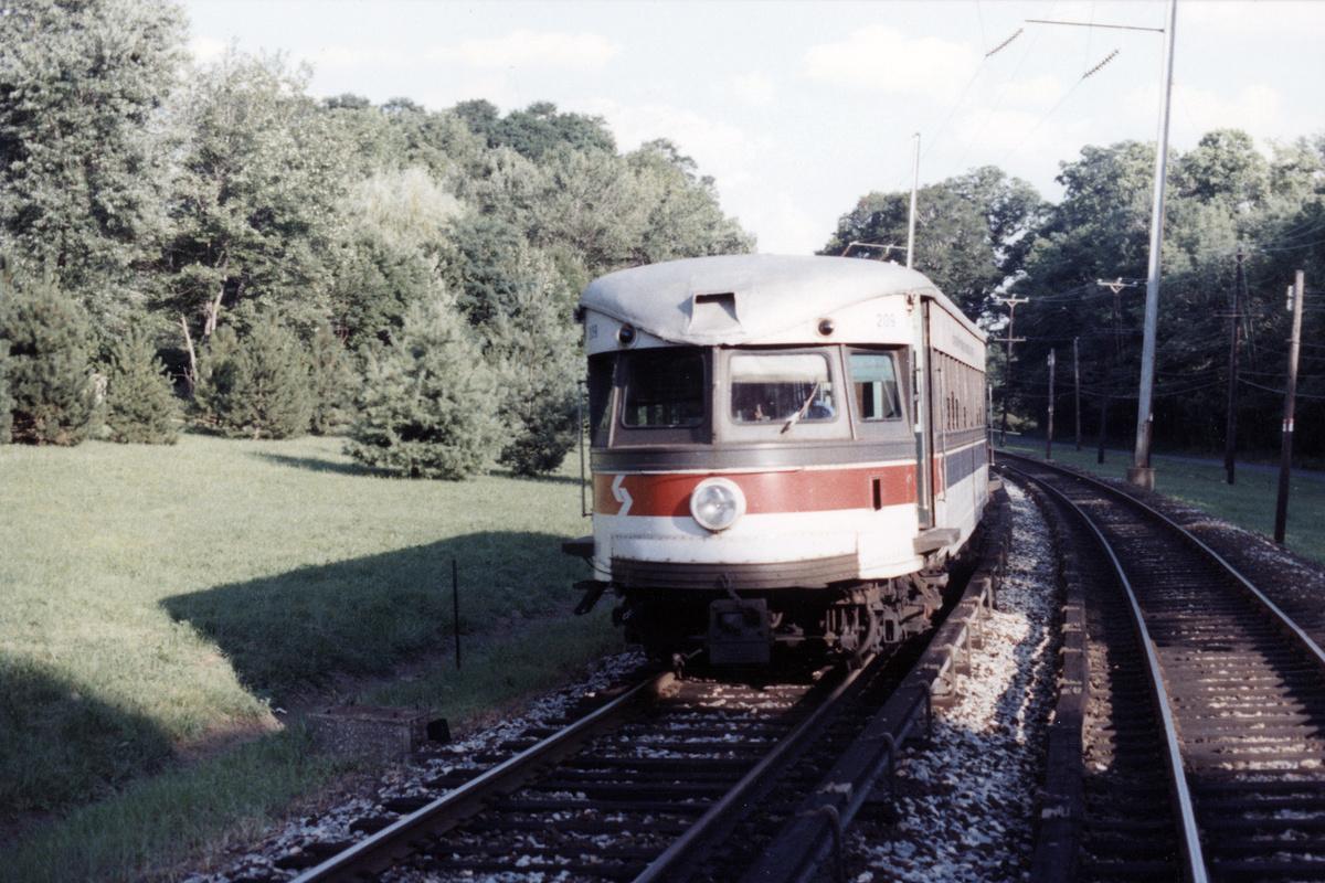 (484k, 1200x800)<br><b>Country:</b> United States<br><b>City:</b> Philadelphia, PA<br><b>System:</b> SEPTA (or Predecessor)<br><b>Line:</b> 100-Norristown<br><b>Location:</b> Norristown line-Loc. unknown.<br><b>Car:</b> PSTC/SEPTA Bullet (J.G. Brill Co., 1931-1934) 209 <br><b>Collection of:</b> David Pirmann<br><b>Date:</b> 1987<br><b>Notes:</b> Summer 1987<br><b>Viewed (this week/total):</b> 7 / 23