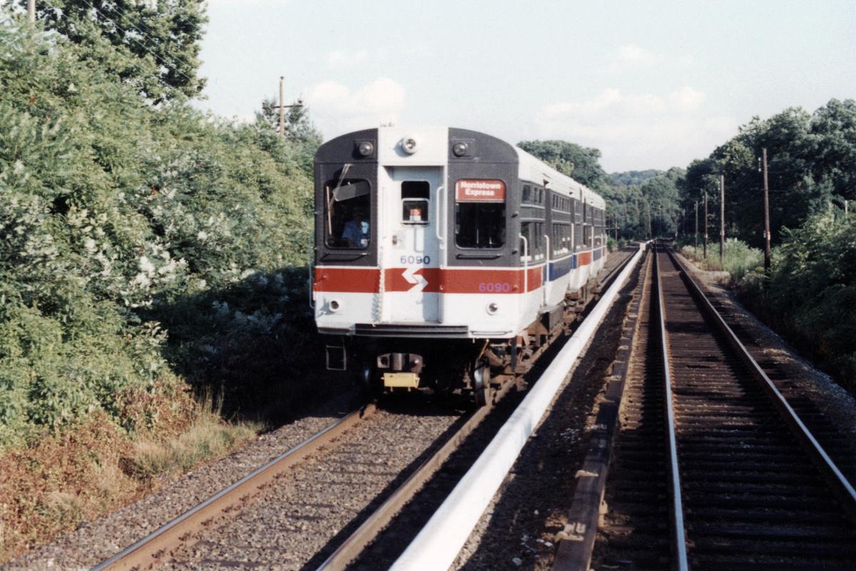 (498k, 1200x800)<br><b>Country:</b> United States<br><b>City:</b> Philadelphia, PA<br><b>System:</b> SEPTA (or Predecessor)<br><b>Line:</b> 100-Norristown<br><b>Location:</b> Norristown line-Loc. unknown.<br><b>Car:</b> SEPTA CTA (Ex-CTA 6000 Series) (St. Louis Car Co.) 6090 <br><b>Collection of:</b> David Pirmann<br><b>Date:</b> 1987<br><b>Notes:</b> Summer 1987<br><b>Viewed (this week/total):</b> 5 / 18