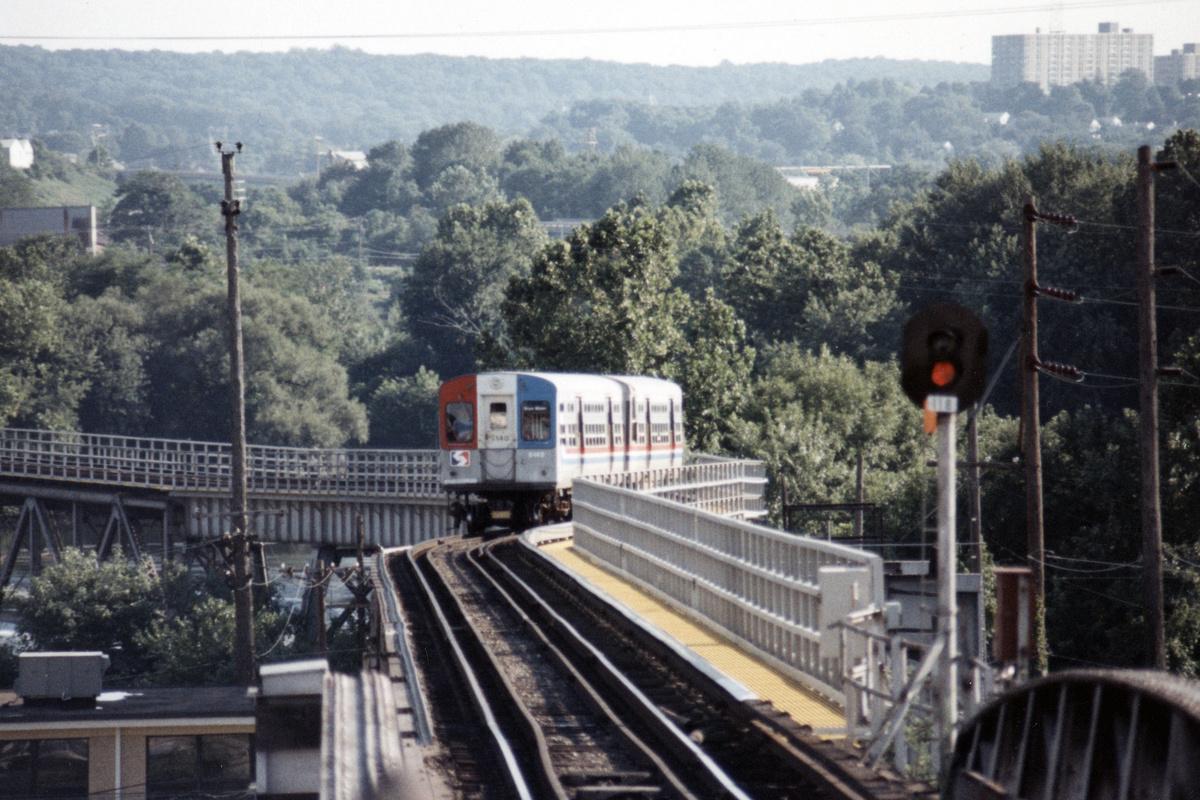 (485k, 1200x800)<br><b>Country:</b> United States<br><b>City:</b> Philadelphia, PA<br><b>System:</b> SEPTA (or Predecessor)<br><b>Line:</b> 100-Norristown<br><b>Location:</b> Norristown line-Loc. unknown.<br><b>Car:</b> SEPTA CTA (Ex-CTA 6000 Series) (St. Louis Car Co.) 6140 <br><b>Collection of:</b> David Pirmann<br><b>Date:</b> 1987<br><b>Notes:</b> Summer 1987<br><b>Viewed (this week/total):</b> 6 / 19