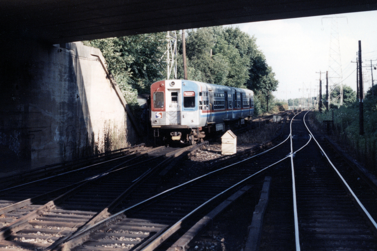 (427k, 1200x800)<br><b>Country:</b> United States<br><b>City:</b> Philadelphia, PA<br><b>System:</b> SEPTA (or Predecessor)<br><b>Line:</b> 100-Norristown<br><b>Location:</b> Bryn Mawr<br><b>Car:</b> SEPTA CTA (Ex-CTA 6000 Series) (St. Louis Car Co.) 6152 <br><b>Collection of:</b> David Pirmann<br><b>Date:</b> 1987<br><b>Notes:</b> Summer 1987<br><b>Viewed (this week/total):</b> 2 / 13