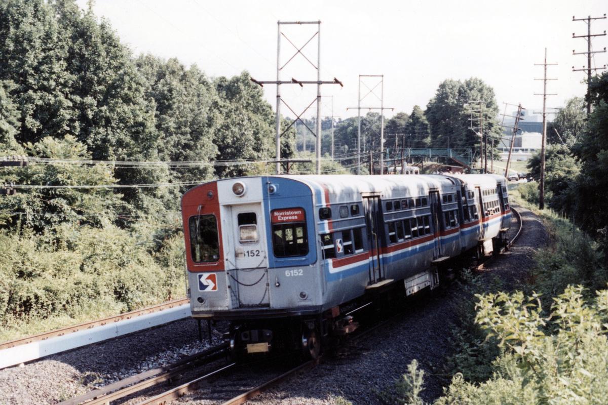 (569k, 1200x800)<br><b>Country:</b> United States<br><b>City:</b> Philadelphia, PA<br><b>System:</b> SEPTA (or Predecessor)<br><b>Line:</b> 100-Norristown<br><b>Location:</b> Norristown line-Loc. unknown.<br><b>Car:</b> SEPTA CTA (Ex-CTA 6000 Series) (St. Louis Car Co.) 6152 <br><b>Collection of:</b> David Pirmann<br><b>Date:</b> 1987<br><b>Notes:</b> Summer 1987<br><b>Viewed (this week/total):</b> 3 / 15