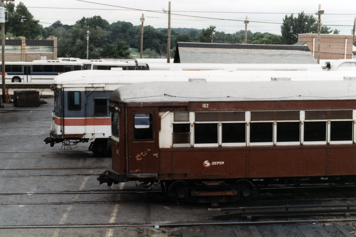 (439k, 1200x800)<br><b>Country:</b> United States<br><b>City:</b> Philadelphia, PA<br><b>System:</b> SEPTA (or Predecessor)<br><b>Line:</b> 100-Norristown<br><b>Location:</b> 72nd (69th) St. Yard-Norristown Line<br><b>Car:</b> PSTC/SEPTA Strafford (J.G. Brill Co., 1927-1929) 162 <br><b>Collection of:</b> David Pirmann<br><b>Date:</b> 1988<br><b>Notes:</b> Summer 1988<br><b>Viewed (this week/total):</b> 3 / 14