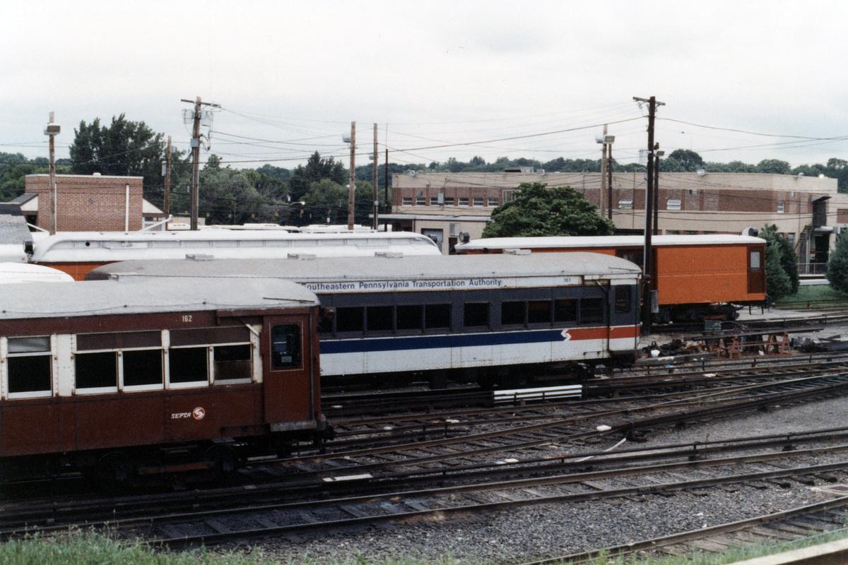 (491k, 1200x800)<br><b>Country:</b> United States<br><b>City:</b> Philadelphia, PA<br><b>System:</b> SEPTA (or Predecessor)<br><b>Line:</b> 100-Norristown<br><b>Location:</b> 72nd (69th) St. Yard-Norristown Line<br><b>Car:</b> PSTC/SEPTA Strafford (J.G. Brill Co., 1927-1929) 162/161 <br><b>Collection of:</b> David Pirmann<br><b>Date:</b> 1988<br><b>Notes:</b> Summer 1988<br><b>Viewed (this week/total):</b> 2 / 11