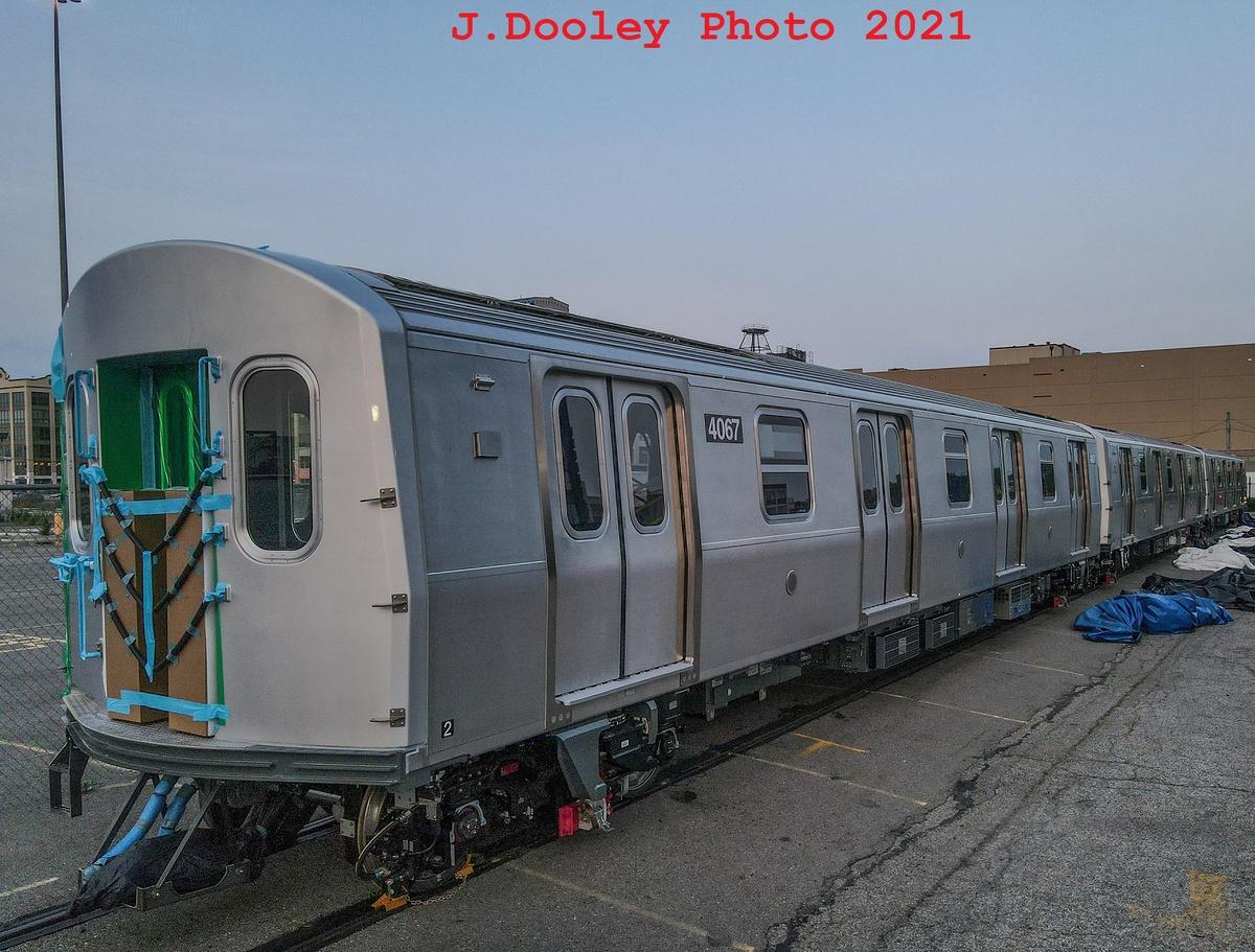 (470k, 1200x911)<br><b>Country:</b> United States<br><b>City:</b> New York<br><b>System:</b> New York City Transit<br><b>Route:</b> Delivery<br><b>Car:</b> R-211 (Kawasaki, 2021-) 4067 <br><b>Photo by:</b> John Dooley<br><b>Date:</b> 7/15/2021<br><b>Notes:</b> Delivery at SBK yard<br><b>Viewed (this week/total):</b> 8 / 179