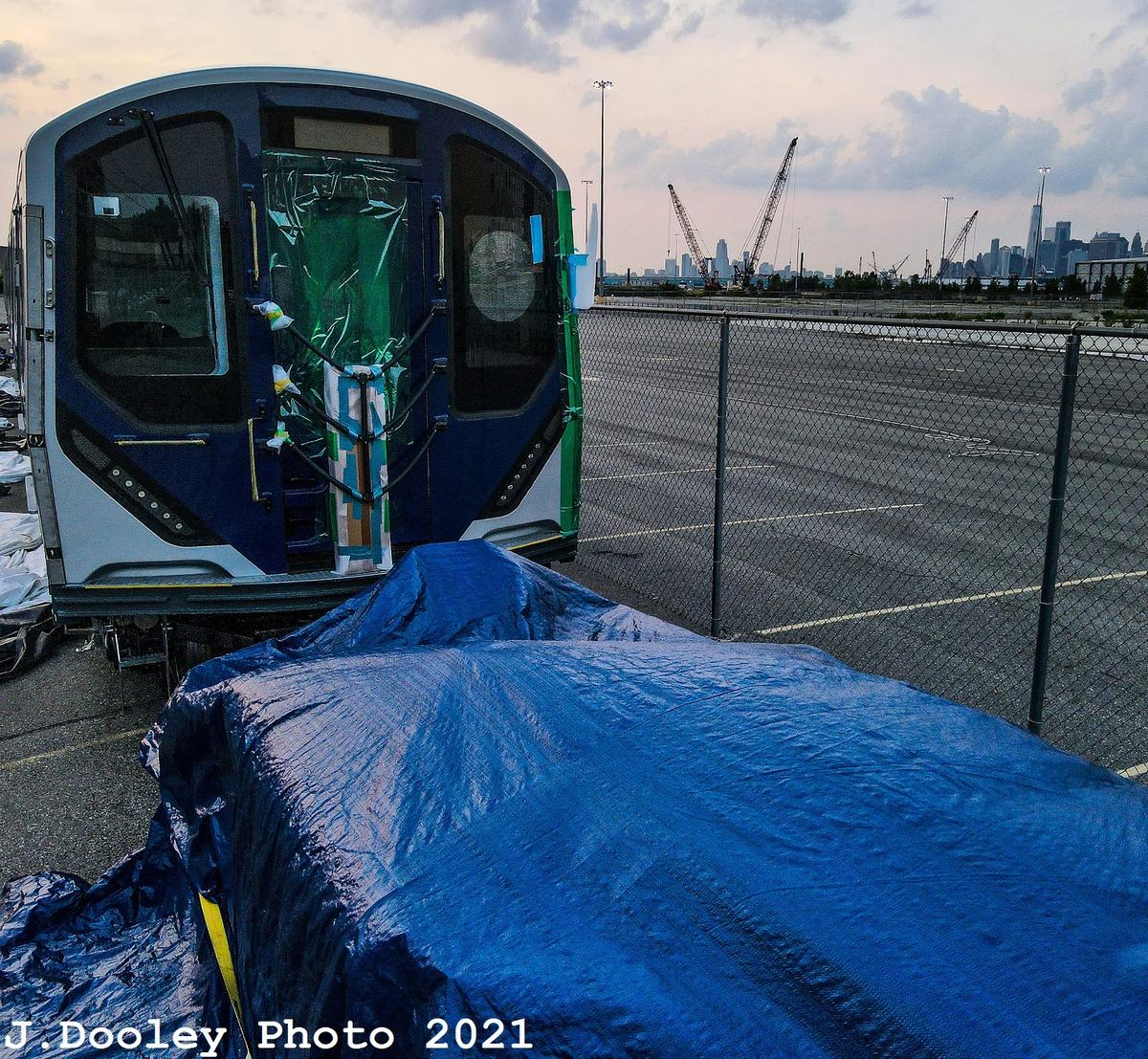(786k, 1200x1107)<br><b>Country:</b> United States<br><b>City:</b> New York<br><b>System:</b> New York City Transit<br><b>Route:</b> Delivery<br><b>Car:</b> R-211 (Kawasaki, 2021-) 4065 <br><b>Photo by:</b> John Dooley<br><b>Date:</b> 7/15/2021<br><b>Notes:</b> Delivery at SBK yard<br><b>Viewed (this week/total):</b> 5 / 134