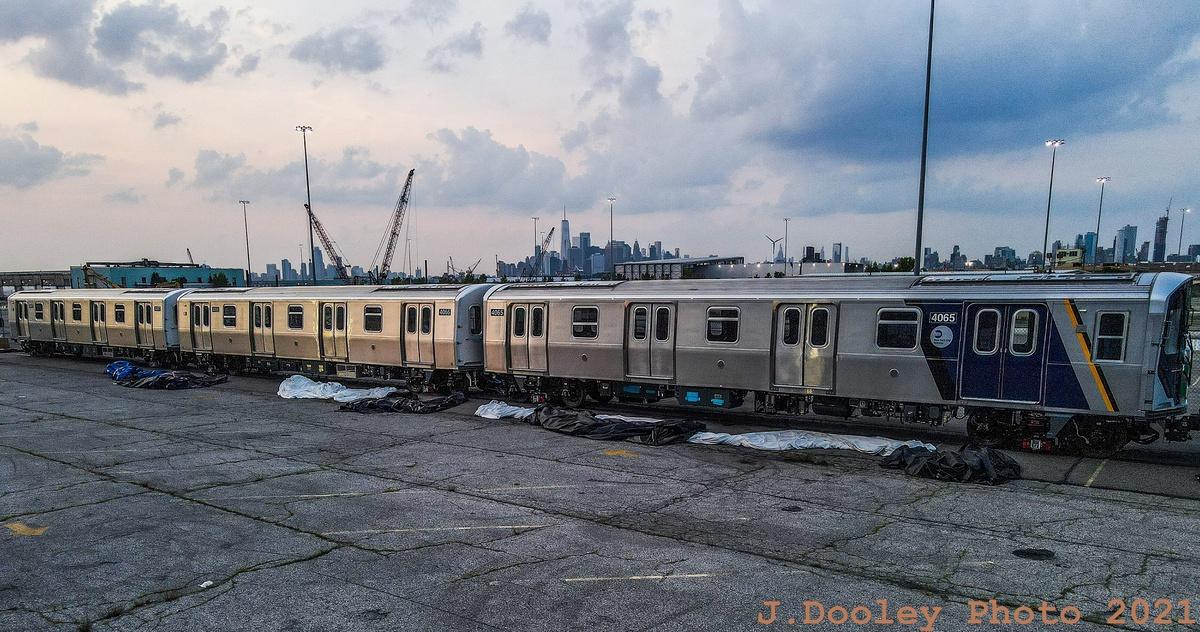 (391k, 1200x632)<br><b>Country:</b> United States<br><b>City:</b> New York<br><b>System:</b> New York City Transit<br><b>Route:</b> Delivery<br><b>Car:</b> R-211 (Kawasaki, 2021-) 4065 <br><b>Photo by:</b> John Dooley<br><b>Date:</b> 7/15/2021<br><b>Notes:</b> Delivery at SBK yard<br><b>Viewed (this week/total):</b> 15 / 166