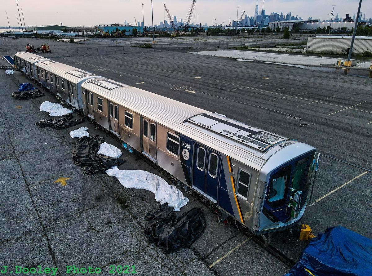 (616k, 1200x890)<br><b>Country:</b> United States<br><b>City:</b> New York<br><b>System:</b> New York City Transit<br><b>Route:</b> Delivery<br><b>Car:</b> R-211 (Kawasaki, 2021-) 4065 <br><b>Photo by:</b> John Dooley<br><b>Date:</b> 7/15/2021<br><b>Notes:</b> Delivery at SBK yard<br><b>Viewed (this week/total):</b> 7 / 289