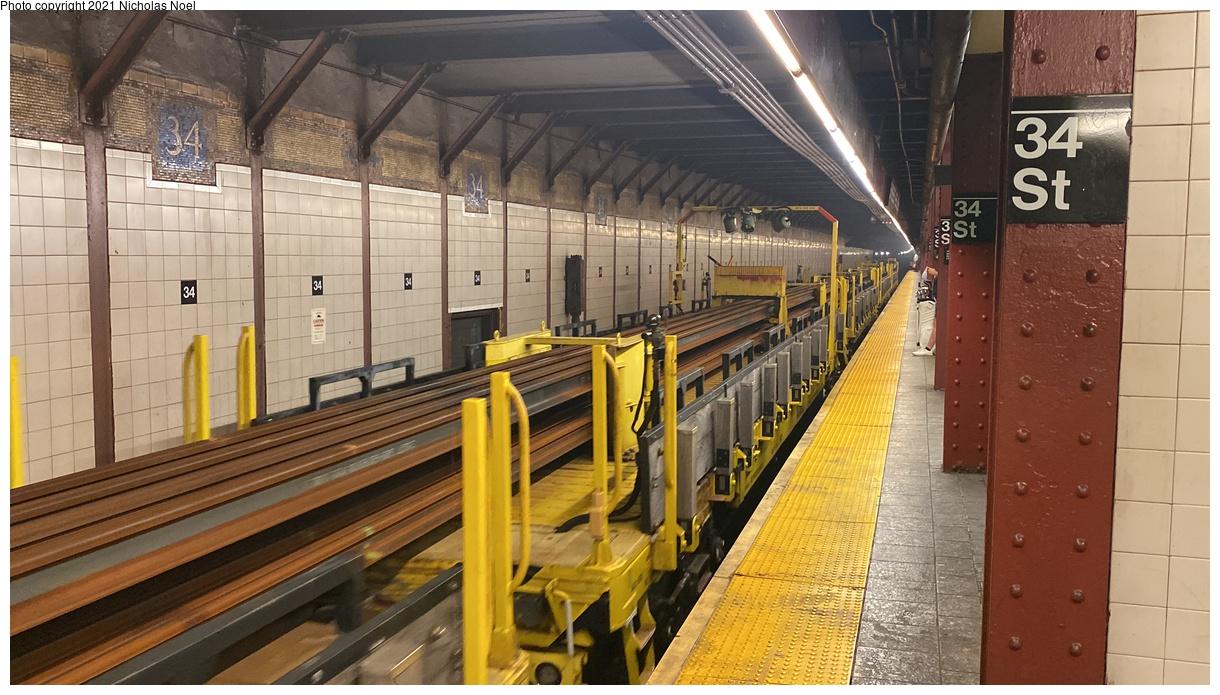 (358k, 1220x695)<br><b>Country:</b> United States<br><b>City:</b> New York<br><b>System:</b> New York City Transit<br><b>Line:</b> BMT Broadway Line<br><b>Location:</b> 34th Street/Herald Square<br><b>Route:</b> Work Service<br><b>Car:</b> BMT Elevated Gate Car  <br><b>Photo by:</b> Nicholas Noel<br><b>Date:</b> 9/28/2021<br><b>Notes:</b> Continuous welded rail flatcars<br><b>Viewed (this week/total):</b> 3 / 53