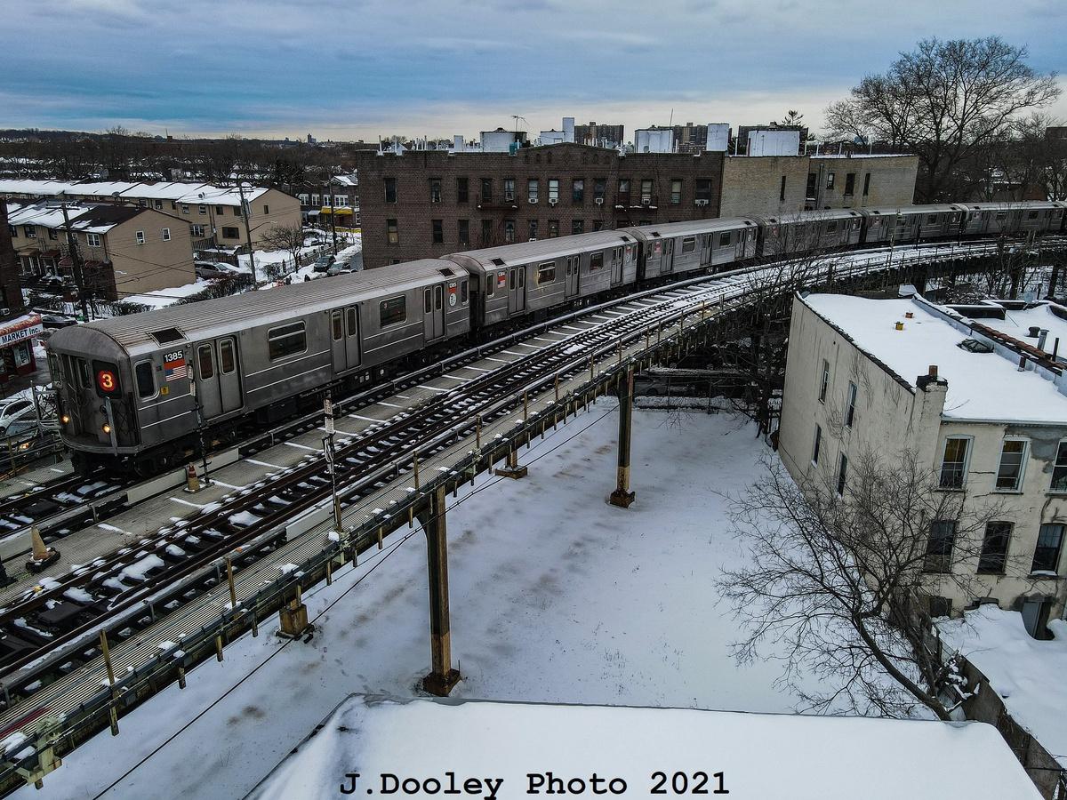 (570k, 1200x900)<br><b>Country:</b> United States<br><b>City:</b> New York<br><b>System:</b> New York City Transit<br><b>Location:</b> Livonia Yard<br><b>Car:</b> R-62 (Kawasaki, 1983-1985) 1385 <br><b>Photo by:</b> John Dooley<br><b>Date:</b> 2/3/2021<br><b>Notes:</b> Put-in from Livonia Yard. Drone shot.<br><b>Viewed (this week/total):</b> 58 / 292