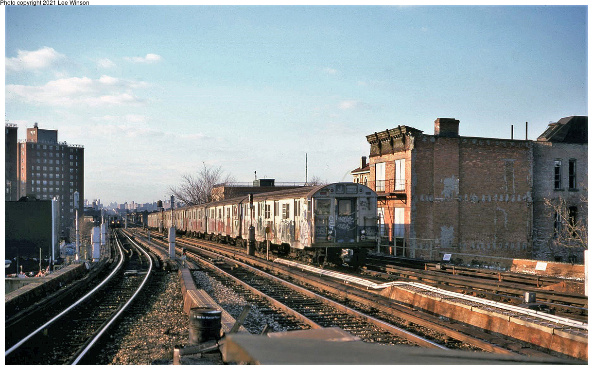(496k, 1220x761)<br><b>Country:</b> United States<br><b>City:</b> New York<br><b>System:</b> New York City Transit<br><b>Line:</b> BMT Nassau Street-Jamaica Line<br><b>Location:</b> Broadway/East New York (Broadway Junction)<br><b>Route:</b> J<br><b>Car:</b> R-30 (St. Louis, 1961) 85xx <br><b>Photo by:</b> Lee Winson<br><b>Date:</b> 1/1979<br><b>Viewed (this week/total):</b> 50 / 294