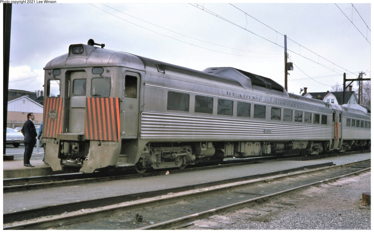 (284k, 1220x763)<br><b>Country:</b> United States<br><b>City:</b> Philadelphia, PA<br><b>System:</b> SEPTA Regional Rail<br><b>Line:</b> SEPTA R8<br><b>Location:</b> Fox Chase<br><b>Car:</b> SEPTA RDC (Ex-RDG) 9158 <br><b>Photo by:</b> Lee Winson<br><b>Date:</b> 4/1975<br><b>Notes:</b> Fox Chase station, RDC #9158 from Newtown. The Reading added orange stripes for grade crossing safety.  RDCs still wore Reading Company on their letterboards and a Reading Lines diamond logo.<br><b>Viewed (this week/total):</b> 6 / 41