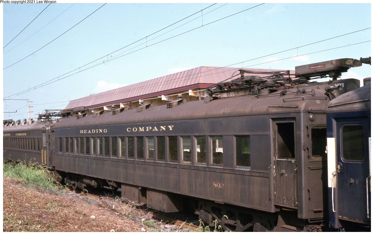 (292k, 1220x767)<br><b>Country:</b> United States<br><b>City:</b> Philadelphia, PA<br><b>System:</b> SEPTA Regional Rail<br><b>Line:</b> SEPTA R2<br><b>Location:</b> Warminster<br><b>Car:</b> SEPTA Blueliner (Ex-RDG) (1931) 803 <br><b>Photo by:</b> Lee Winson<br><b>Date:</b> 8/1974<br><b>Notes:</b> Reading MU #803 on weekend layover at new station. Shows rooftop power line.<br><b>Viewed (this week/total):</b> 5 / 31